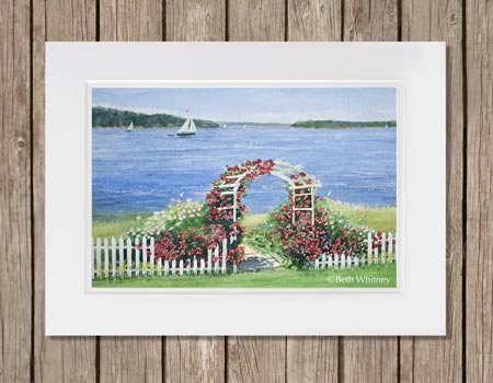 Watercolor painting of a white arbor and picket fence with red roses climbing on it next to the ocean by artist Beth Whitney | DowneastWatercolors.com