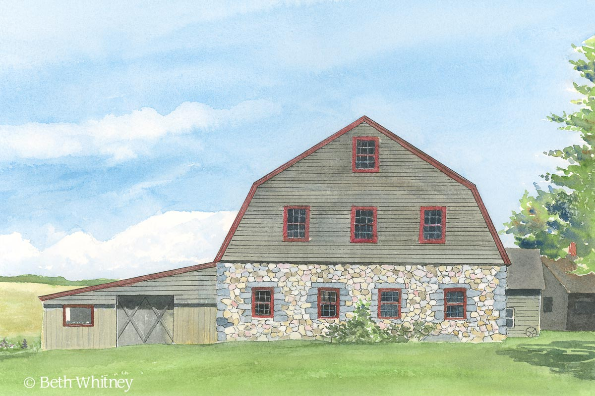 Stone Barn with shingles and red trim under blue sky